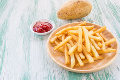 French fries on a wooden background Stock Photos