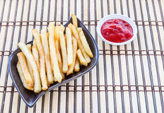 French fries on a wooden background Stock Images