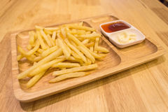 French fries. On wooden dish Stock Photography