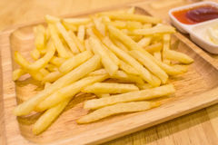 French fries. On wooden dish Royalty Free Stock Photos