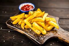 French fries on wooden table Stock Images