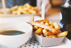 French fries on wooden table Royalty Free Stock Photo