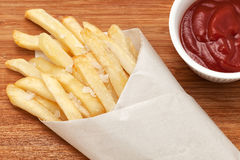 French fries in wrapping paper Stock Photos