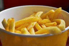 French fries close-up. French fries in a yellow box close-up royalty free stock image