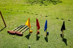 French Garden Lawn Croquet Flags and mallets. On a bright sunny day Royalty Free Stock Images