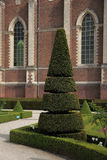 French garden at old Gothic church in Belgium. Royalty Free Stock Photography