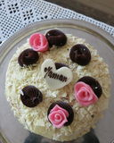 French gateau. Delicious gateau for Mothers day with meringue,cream,nuts,chocolate and  marzipan, a heart of marzipan on top Stock Photos