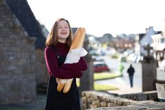 French girl with baguettes Stock Images