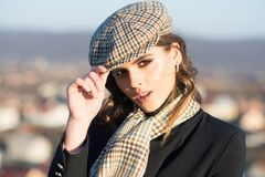French girl with curly hair in autumn beret. retro fashion woman with makeup, parisian. Beauty and fashion look royalty free stock photos