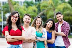 French girl with male and female young adults in line stock images