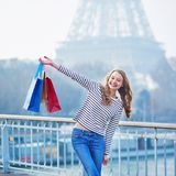 French girl with shopping bags near the Eiffel tower in Paris Royalty Free Stock Images