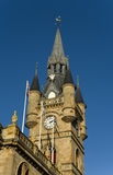 French-Gothic architecture. Detail of the recently refurbished town hall of Renfrew, Scotland, showing thistle-decorated turretted tower with weathervane in Royalty Free Stock Images