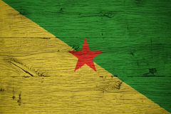 French Guiana national flag painted old oak wood. French Guiana national flag painted on old oak wood. Painting is colorful on planks of old train carriage Stock Image