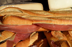 French ham baguette. French baguette sandwich with smoke ham and cheese in the background Stock Images