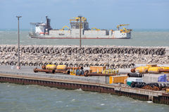 French harbor Calais with dredging ship navigating outside the h. HARBOR CALAIS, FRANCE - JUNE 07, 2017: French harbor of Calais with dredging ship navigating Royalty Free Stock Images