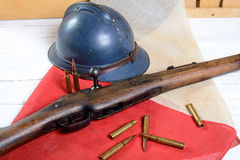 French helmet of the First World War with a gun on a blue white Stock Photo