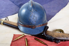 French helmet of the First World War with a gun on french flag Stock Photo