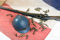 French helmet of the First World War with a gun on french flag Stock Photos