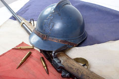 French helmet of the First World War with a gun on a red white b Royalty Free Stock Images