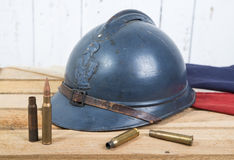French helmet and old french flag Royalty Free Stock Image