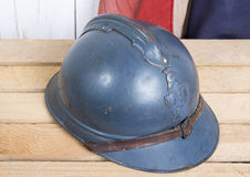 French helmet and old french flag Stock Image