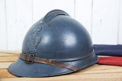 French helmet and old french flag Stock Photography