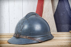 French helmet and old french flag. French helmet of World War I  and old french flag Stock Photos