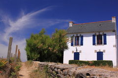French holiday house france. Holiday house in the dunes of the coast in France. House to rent for holiday with blue sky Royalty Free Stock Photos