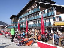 French holiday skiers relax at an outdoor restaurant Stock Photography