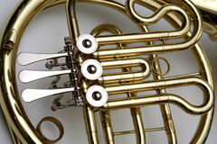 French Horn. Fragment. Wind musical instrument Stock Image