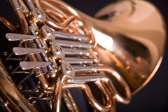 French Horn. On dark background Royalty Free Stock Photos