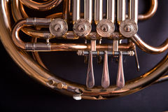 French Horn. On dark background Royalty Free Stock Image