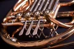 French Horn. On dark background Royalty Free Stock Photo