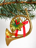French horn. Christmas decorations opposite white background Royalty Free Stock Image