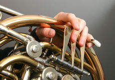 French horn. Fingers playing a french horn Royalty Free Stock Images