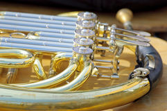 French horn background. Close up view of french horn Royalty Free Stock Photography
