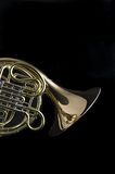 French Horn on Black Background. A French Horn on Black Background  in the portrait or vertical view Royalty Free Stock Photography