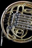 French Horn on Black Background. A French Horn on Black Background  in the portrait or vertical view Royalty Free Stock Photo