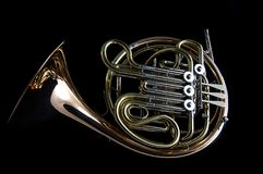 French Horn on Black Background. A French Horn on Black Background in the landscape or horizontal view Stock Images