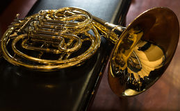 The French horn. On a chair Royalty Free Stock Photos