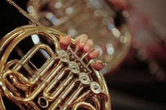 French Horn. Detail close up of French Horn musical instrument, part of the Brass family of instruments Stock Images