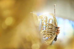 French horn with fingers, valves and tubes. And a thin depth of field Royalty Free Stock Images