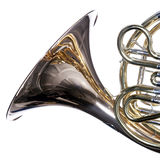 French Horn Isolated Against White. A gold brass French horn close up isolated against a white background  in the square format Stock Photos