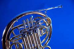 French Horn Isolated On BLue Stock Photo