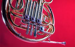 French Horn Isolated On Red. A French Horn instrument isolated against a red background in the horizontal format Royalty Free Stock Photos