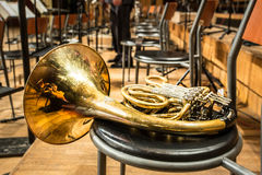 French horn lying on the chair Stock Image