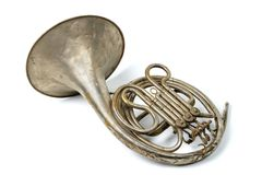 French horn. Old vintage rusty French horn on a withe background stock photography