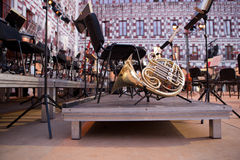 French horn over stage Stock Image