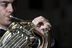 French horn player. Hornist playing brass orchestra music instrument stock photo
