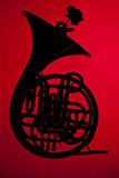 French Horn Silhouette on red Stock Photography